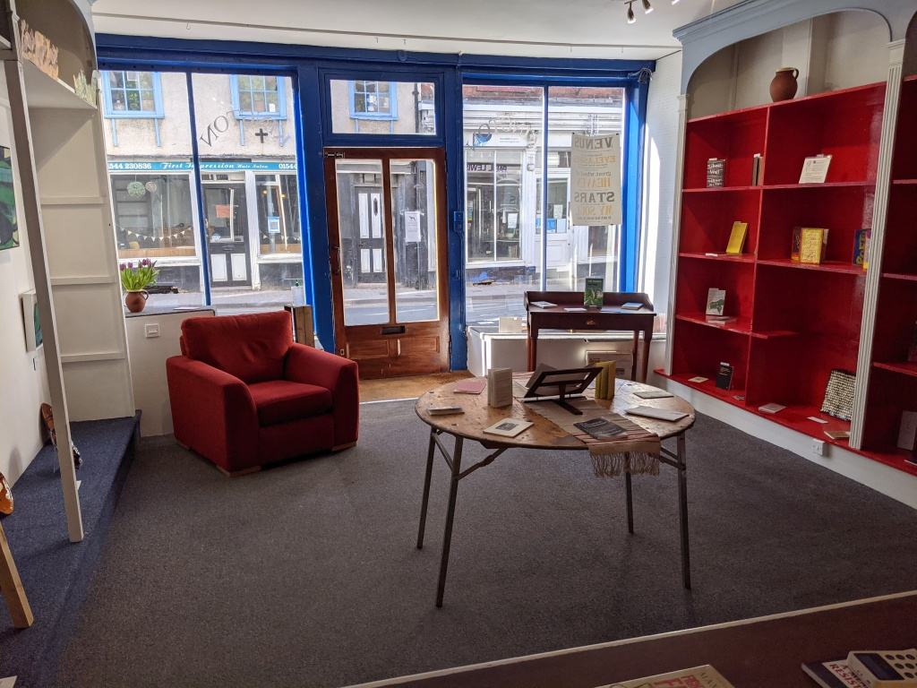inside Lockdown books: a chair, a table and lots of radical books